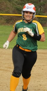 Sophomore Tara Driver smiles her way around the bases after hitting a 3-run homer in the sixth inning
