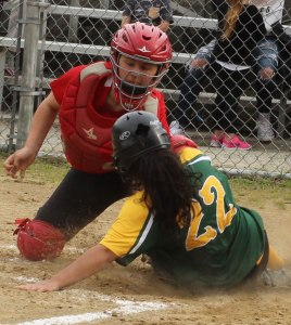 Catcher Caity Baker applies the tag at home to Jessica Ferrazzani
