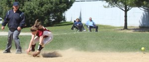Ball goes through shortstop Scout Boynton in the 3-run Amesbury 4th inning