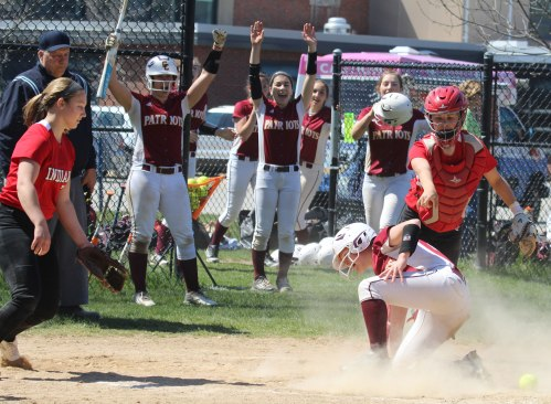 Teammates celebrate Catherine Kingman's HR in the sixth inning