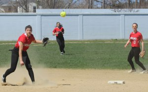 Shortstop Maddie Napoli fires to first base
