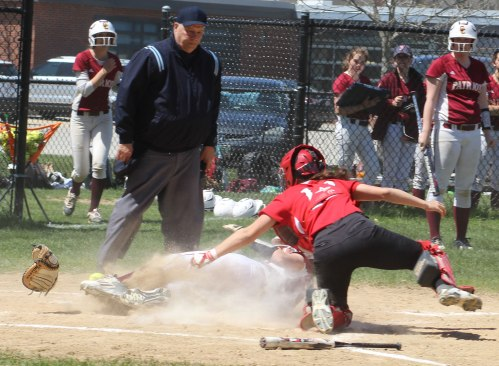 Virginia Ryan slides the ball and glove loose from Amesbury catcher Caity Baker in the Concord-Carlisle first
