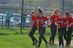 Caity Baker (13) celebrates her sixth-inning home run