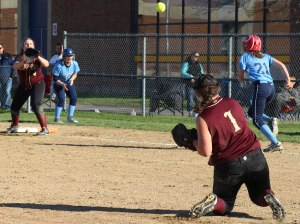 Pitcher Stephanie Gleason gets an out from her knees