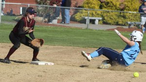 Annie Siemasko awaits the ball and baserunner Zoe Cesati