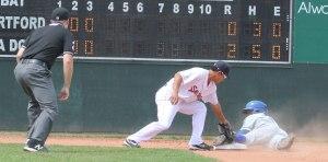 Shortstop Tzu-Wei Lin tags out Rosell Herrera