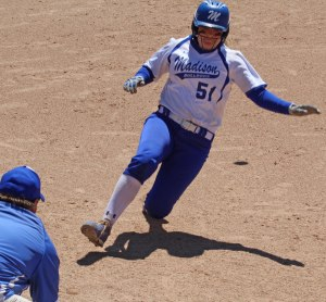 Aly LeBlanc about to reach third after driving in the go-ahead run for Madison