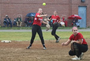 3B Adrienne Harris throws to first