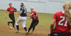 Lauren Fedorchak tags before throwing to first for a double play in the 6th inning