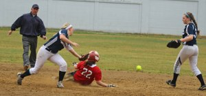 Megan Reid jars the ball loose at second