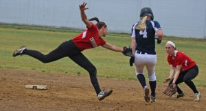 Shortstop Maddie Napoli lunges and tags out Maeve Maynihan