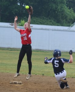 Senior 2B Lauren Fedorchak leaps for a throw as Abby Duggan slides.