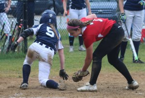Abby Duggan gets past pitcher Haley Catania scoring the first MA run