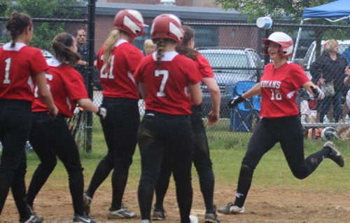 Adrienne Harris greeted by teammates at home after a 2-run homer in the third inning
