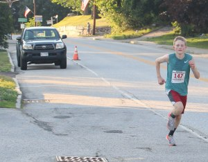 Nick Hoch runs alone past Long Lake Park