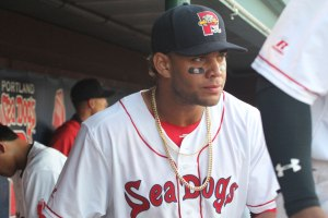 Yoan Moncada emerges from the Portland dugout