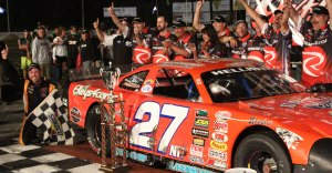The trophy, the car, and an excited crew.
