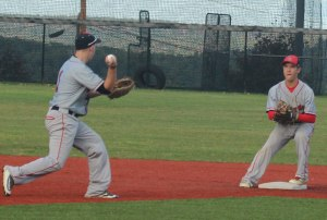 Central Maine shortstop Kyle Moore tosses to 2B Trent Spaulding