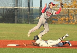 Stefan Strachan slides into second as Trent Spaulding leaps for the throw