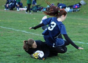 Ella Spiess flies over Amesbury goalie Alli Napoli