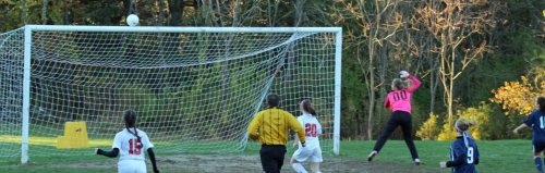 Amesbury shot grazes the crossbar in the first half
