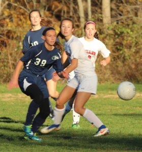 Virginia Vienneau (39) chases a loose ball