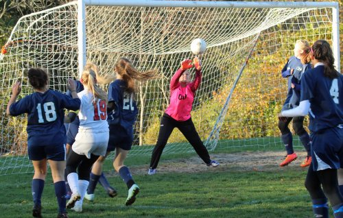 The shot of Mollie Lynch (19) goes over ET goalie Olivia Cassidy