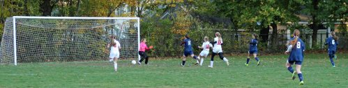 Chelsea Lynch (12) finds the far corner for Amesbury's second goal