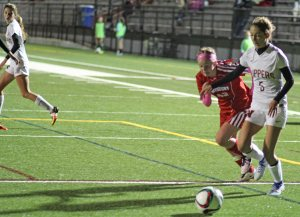 Amelia Kroschwitz (5) tries to get away from Haley Mignon (42)