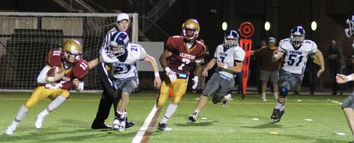 Bryan Hughes (21) tries to trap Clipper QB Rob Shay in the end zone