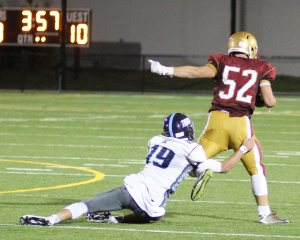 Triton QB Lewi L'Heureux turns defender after giving up an interception to Brian Toolan.