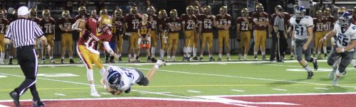 Jack McCarthy (58) has Newburyport QB Rob Shay by the ankle.