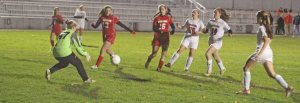 Sophia Carter (26) and Ashlee Porcaro (14) in on GK Melissa Fonseca