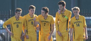 Nauset defenders await a direct kick