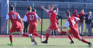 Mike Budrewicz and teammates celebrate goal