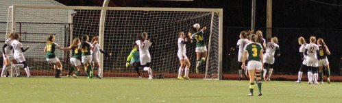 Marissa Zarella (14) gets a head on a corner kick