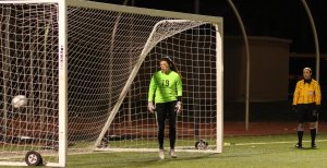 Audra Greenblott's PK is past disappointed NR goalie Kat Hassapis