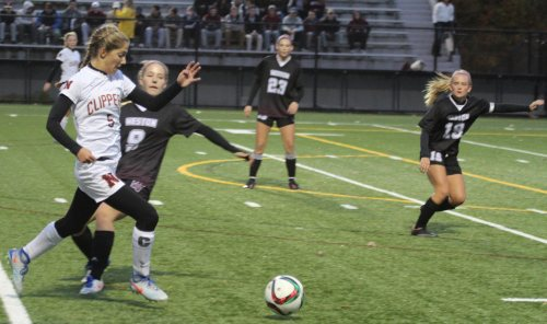 Amelia Kroschwitz had a goal and two assists. Her she powers past a Weston defender