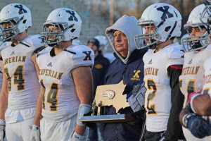 Xaverian coach Charlie Stevenson with the Hawks trophy