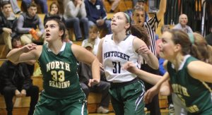 Taylor Moore (33) and Emily Riley (31) eye one of the many rebounds off of free throws.