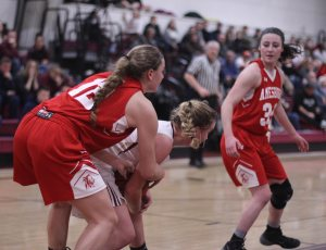 Flannery O'Connor tries to get the ball from Katie Hadden