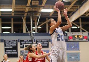 Tessa Lafrance puts in a rebound