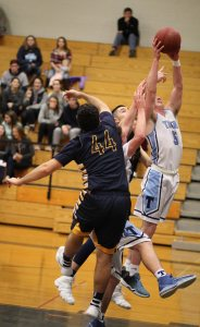 Liam Spillane's collects a rebound