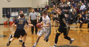 Colin Brennan (16 points) to the hoop