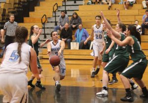Mel Primpas sets up teammate Bridgett Sheehan for a layup with a nice pass
