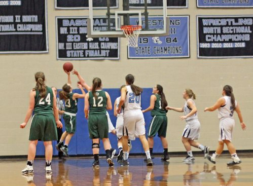 Kaitlyn O'Connell (#23) makes a key left-handed layup over a Triton defender.