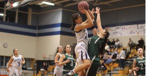 Bella Pomeroy defends a Tessa Lafrance layup attempt