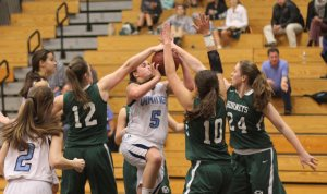 Bridget Sheehan gets her shot blocked by Mel Carter (#12) and Sarah Robinson (#24).
