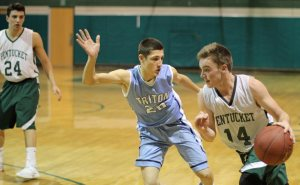 Gus Flaherty (10 points) drives on Dylan Shute