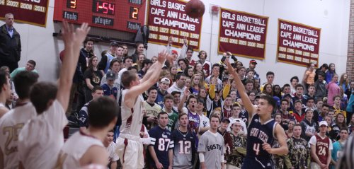 Nick Rogers shoots from in front of the NHS student section